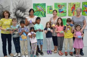 Art classes in Solihull: image of families with their artwork produced in family arts workshops with Art at the Heart CIC at The core in Solihull