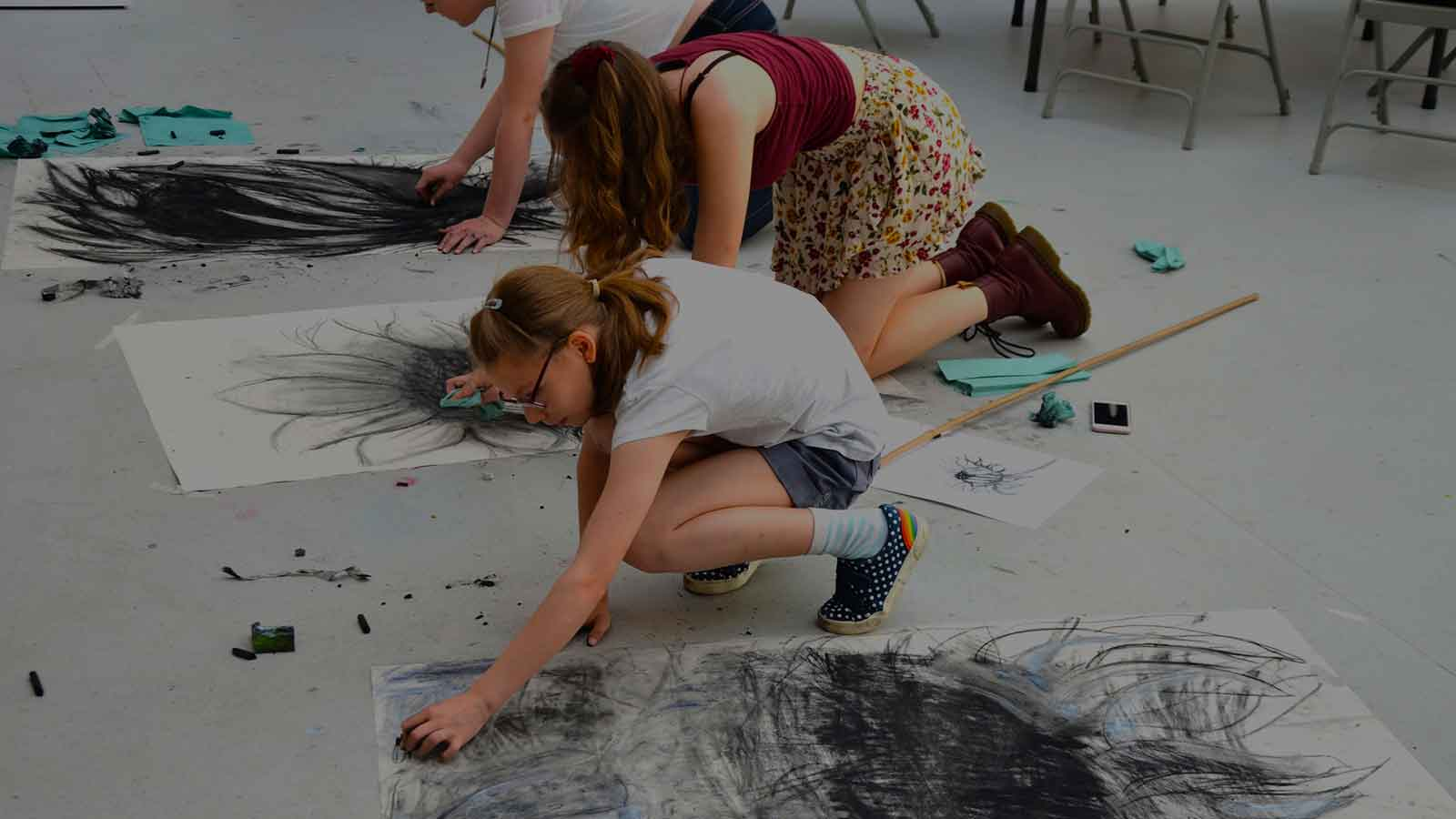 Young people creating large scale artwork in Art at the Heart CIC's Youth Arts Workshops