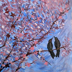Pair of birds sitting in a blossom tree