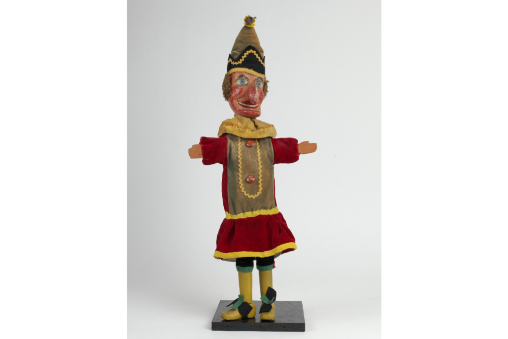 Puppet with red and yellow costume