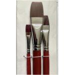 Close-up of three flat nylon hair brushes by Artway