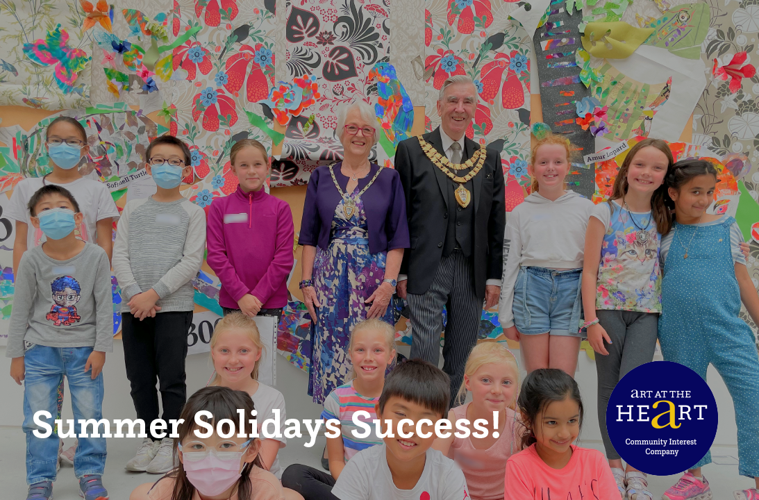 Children with the Mayor in front of the Wild World community artwork during Summer Solidays